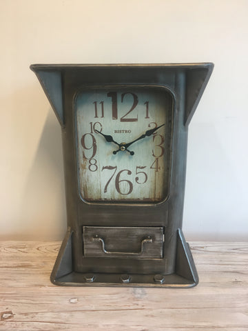 Design led crafted metal clock