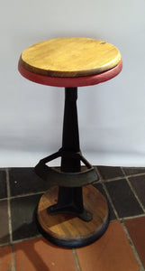 Cast iron stool with reclaimed wood seat.