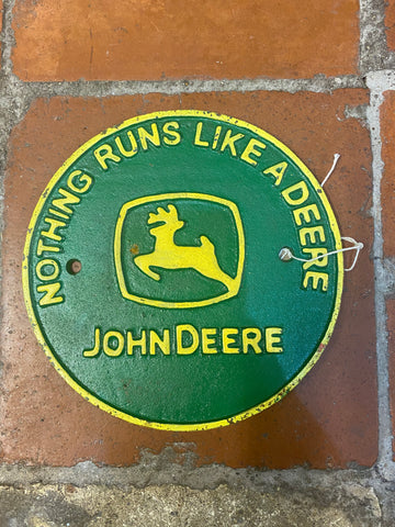 Cast iron John Deere sign