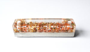 Autumn Workbench - Clear resin filled with gold and prismatic flakes on a base of concrete