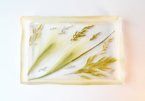Prairie Rolling Tray – Made of clear resin filled with prairie grasses.