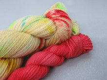 Load image into Gallery viewer, Gold Sparkle 4ply in Merry and Bright colourway with a festive red mini skein