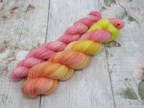Bluefaced Leicester and Nylon 4ply 50g in Shepherds Delight colourway with a mini skein in pink