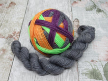 Load image into Gallery viewer, Silver Sparkle Self Striping Yarn in Spooktacular Stripes colourway with a coordinating mini skein