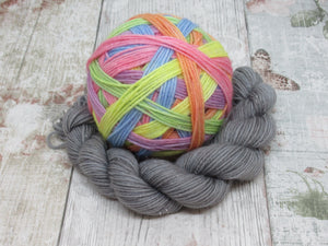 Silver Sparkle Self Striping Yarn in Rainbows and Stormclouds colourway with a coordinating mini skein