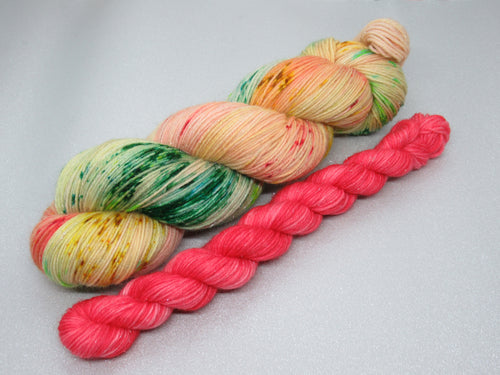 Silver Sparkle 4ply in Merry and Bright colourway with a festive red mini skein