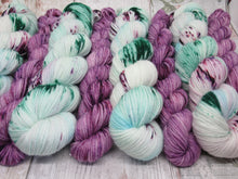 Load image into Gallery viewer, DYED TO ORDER Silver Sparkle 4ply 50g in Sea Glass colourway with a purple speckled mini skein