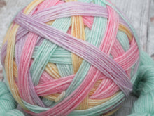 Load image into Gallery viewer, Silver Sparkle Self Striping Yarn in Fruit Pastels colourway with a coordinating mini skein