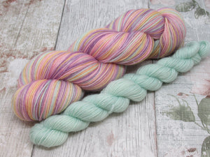 Silver Sparkle Self Striping Yarn in Fruit Pastels colourway with a coordinating mini skein
