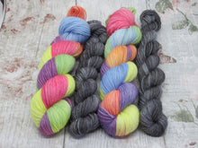 Load image into Gallery viewer, Silver Sparkle 4ply 50g in Rainbow colourway with a mini skein in Stormcloud