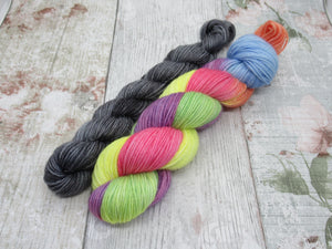 Silver Sparkle 4ply 50g in Rainbow colourway with a mini skein in Stormcloud
