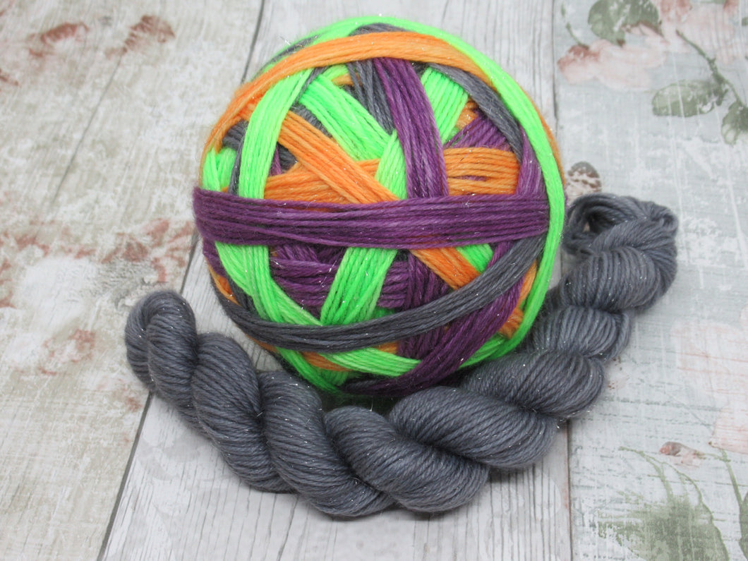 Silver Sparkle Self Striping Yarn in Spooktacular Stripes colourway with a coordinating mini skein