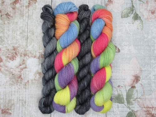 Bluefaced Leicester and Nylon 4ply 50g in Rainbow colourway with a mini skein in Stormcloud