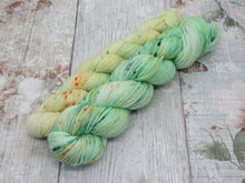 Load image into Gallery viewer, Silver Sparkle 4ply 50g OOAK in a speckled green colourway with a yellow speckled mini skein