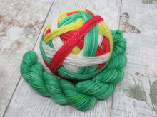 Load image into Gallery viewer, DYED TO ORDER Silver Sparkle Self Striping Yarn in Christmas Elf colourway with a coordinating mini skein