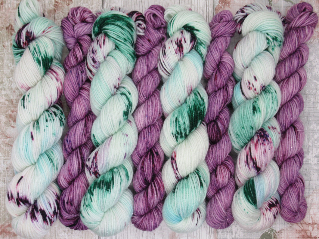 DYED TO ORDER Silver Sparkle 4ply 50g in Sea Glass colourway with a purple speckled mini skein