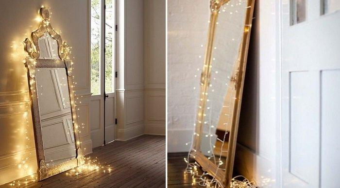 By attaching a garland around the perimeter of the mirror, you create an interesting and practical solution.