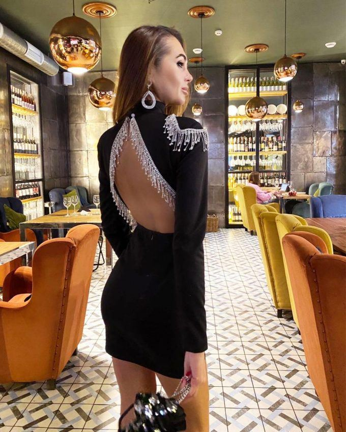 An open back evening dress is sexy and feminine.