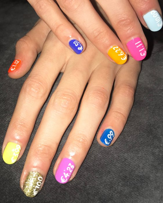 At the United Colors of Benetton show, models wore rainbow manicure on their hands