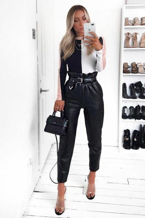 Black and white tight-fitting turtleneck combined with a chain, leather black straight-leg trousers with a high gathered waist and a belt