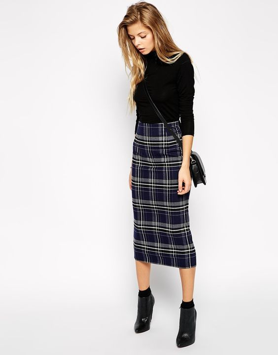 Black check turtleneck combined with a blue check pencil skirt below the knee, high black socks, heeled ankle boots with a pointed toe, belt bag.