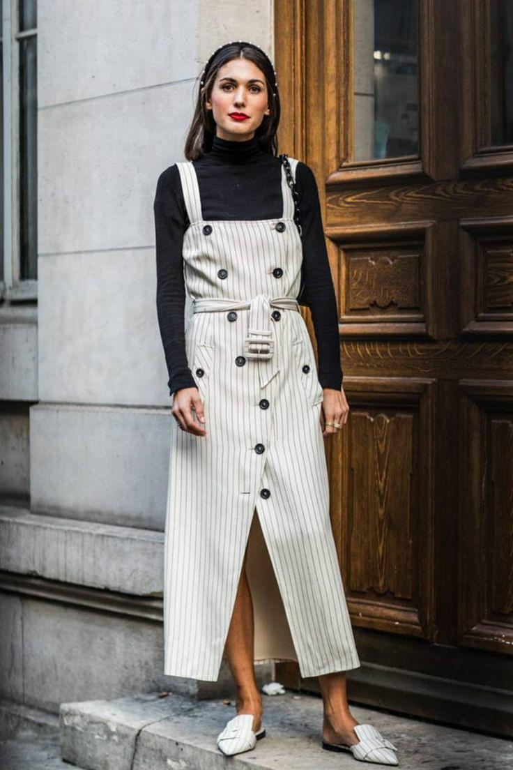 Black turtleneck with a collar combined with a white sundress with a horizontal gray strip,