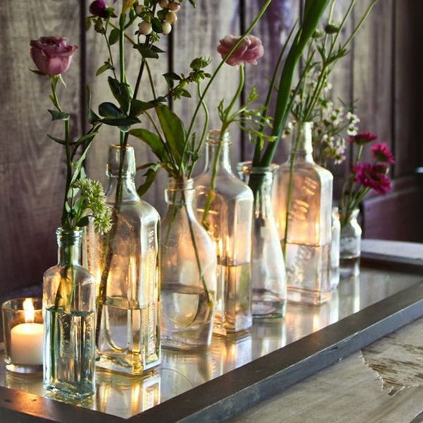 Composition of bottles with flowers