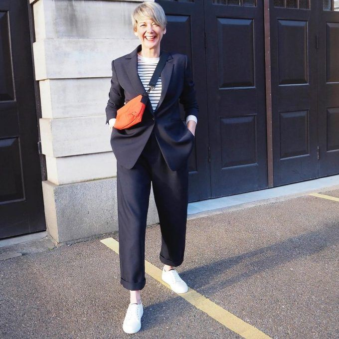 There is a way out - to combine a trouser suit with sneakers.
