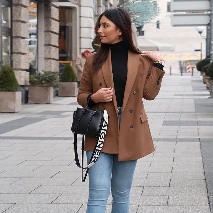 Dress in a double breasted blazer and khaki breeches for a casual level of dress