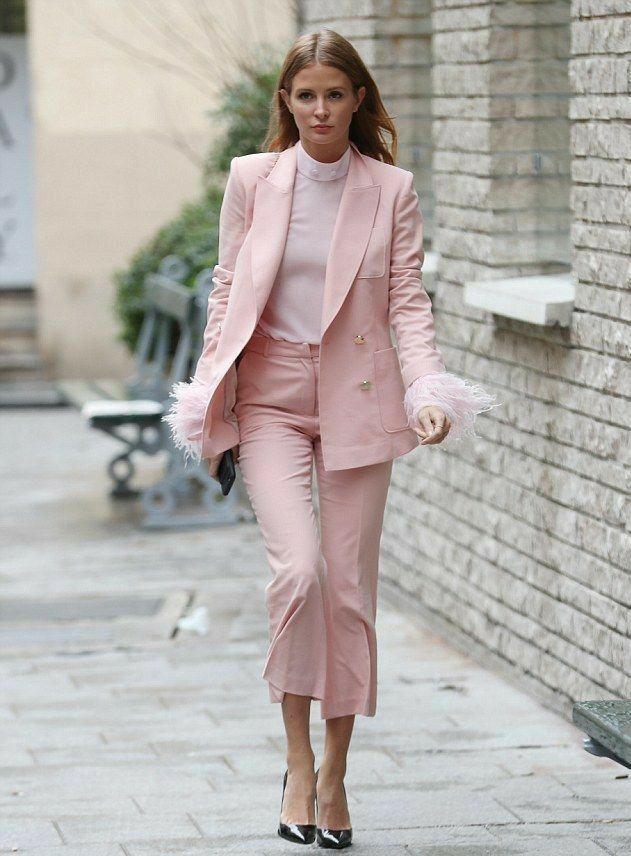 White sheer turtleneck with a low neck, decorated with pearls and fringed sleeves in combination with a pale pink suit