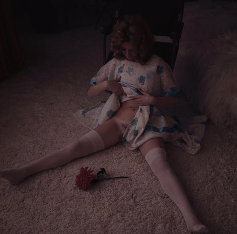Marianne Gordon lifting nightgown on floor