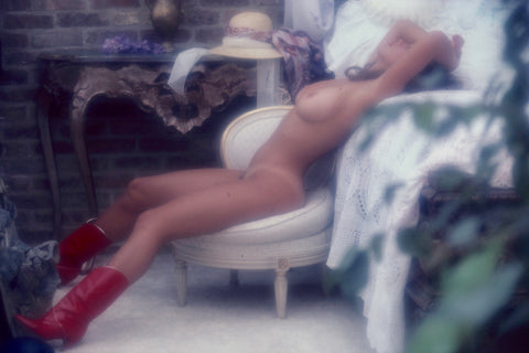 Carmen Pope naked on chair with red boots