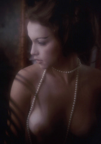 Lona Simpson naked with pearl necklace
