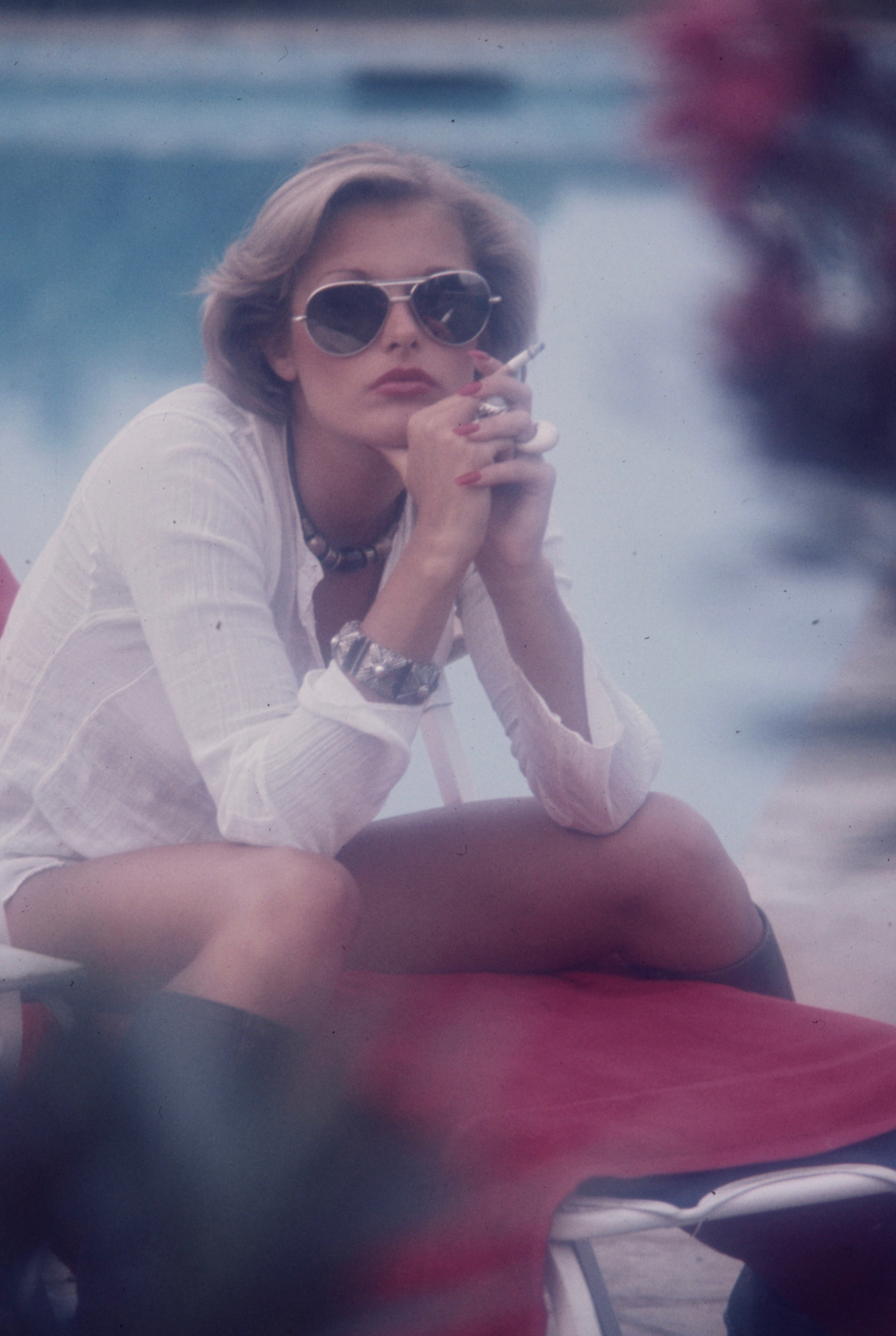 Jane Hargrave smoking a cigarette with sunglasses