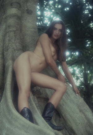 Sasha Vinni naked under a tree