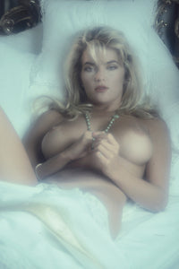 Brandy Ledford laying naked on bed