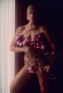 Delia Sheppard covering naked body with flowers