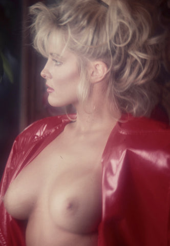 Simone Brigette breast exposed in red leather coat