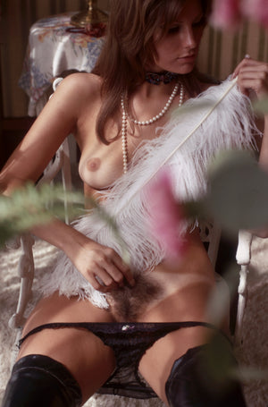 Lane Coyle naked on chair with feather
