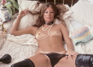 Lane Coyle naked on bed with pearl necklace
