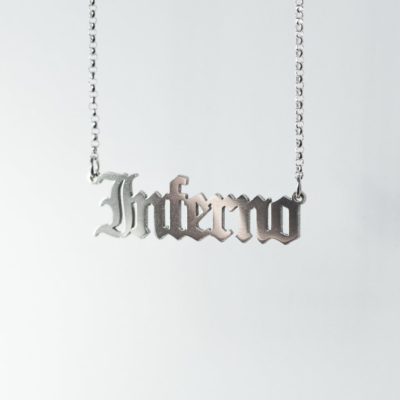 Sterling silver Inferno Necklace in gothic blackletter font.