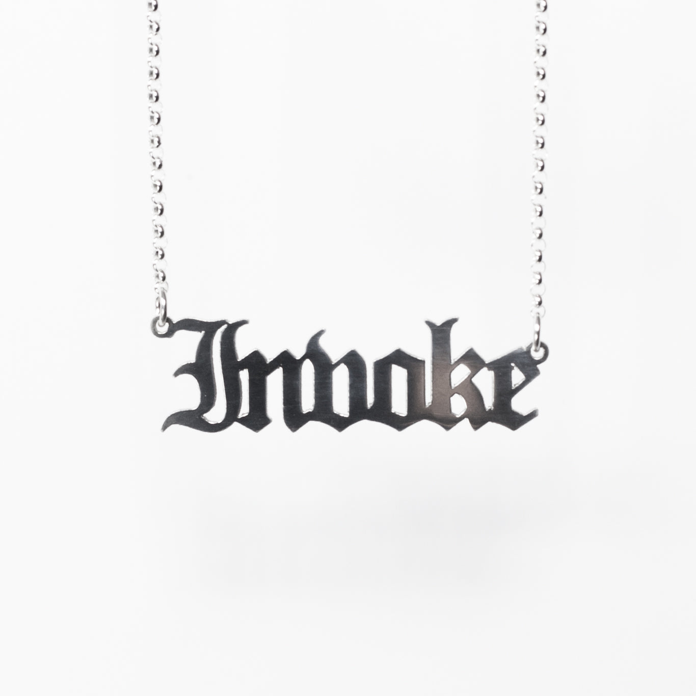 Invoke Necklace in gothic blackletter font. Handmade in sterling silver.