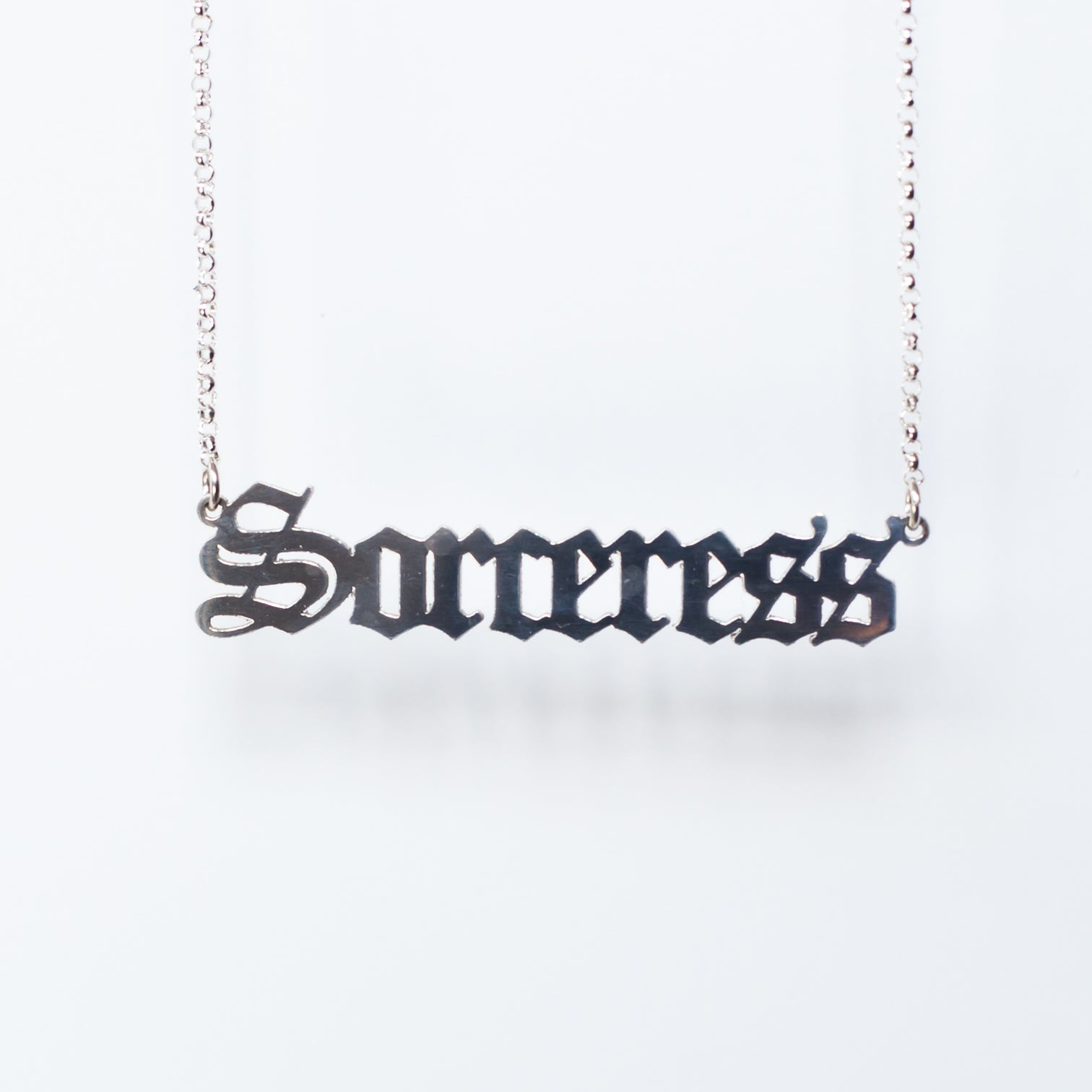 Sorceress Necklace in gothic blackletter font in sterling silver