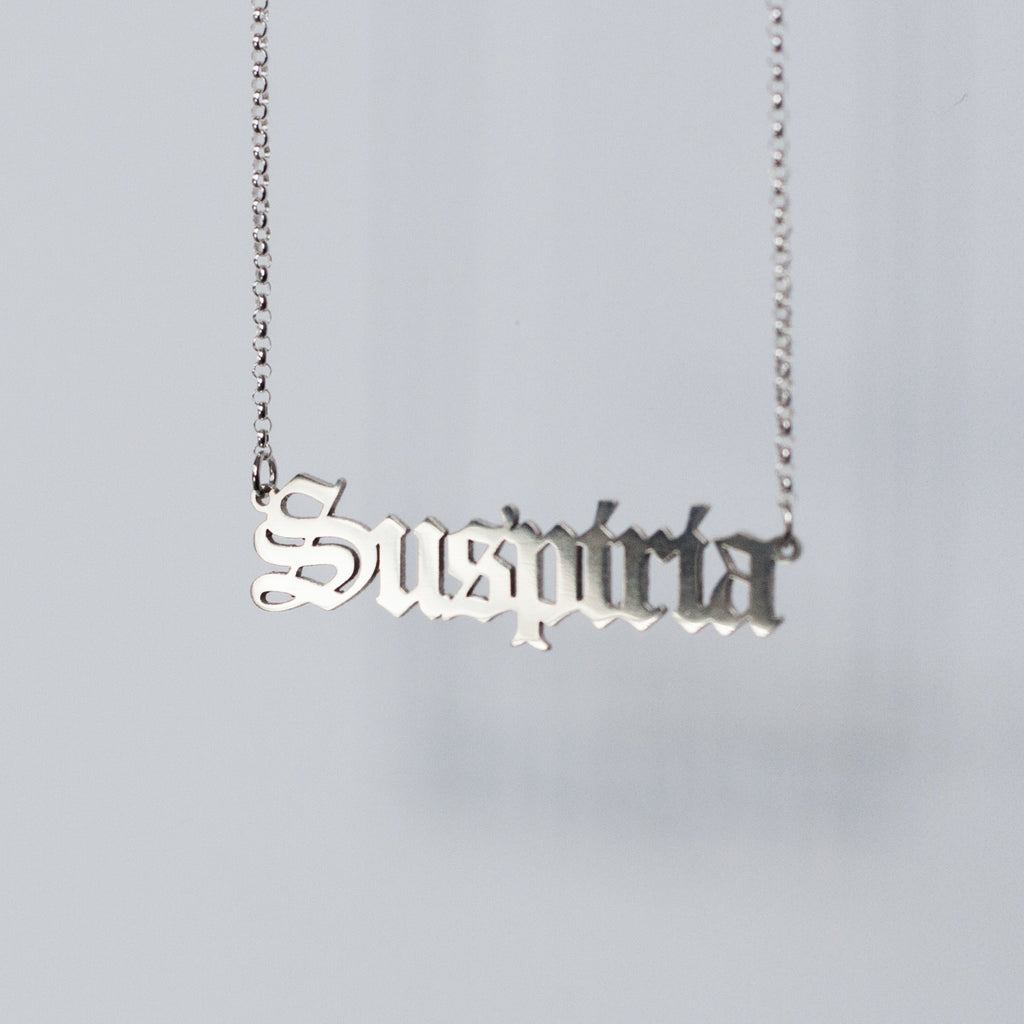 Suspiria Necklace in gothic blackletter font handmade in sterling silver.