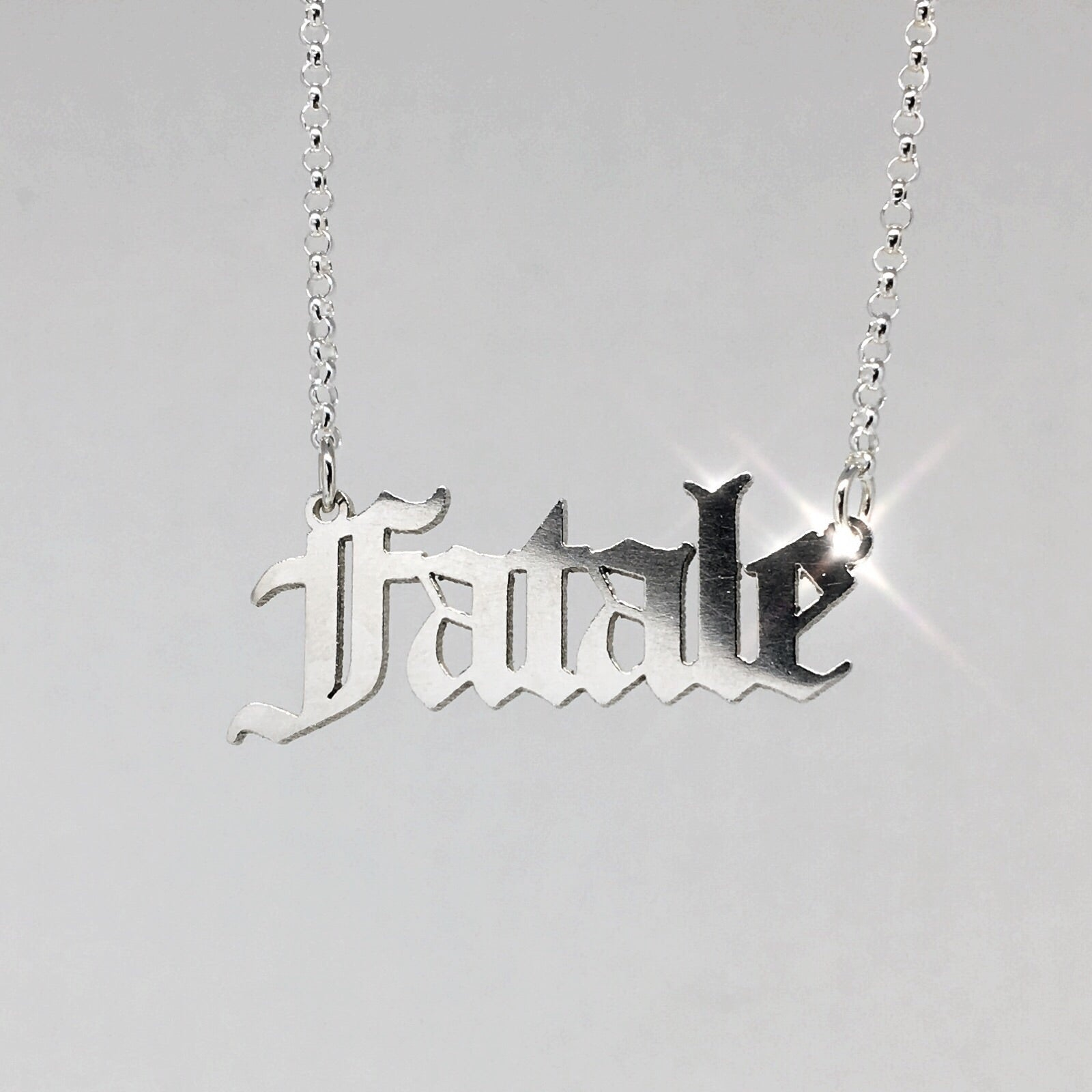 Sterling silver Fatale nameplate necklace in gothic blackletter font.