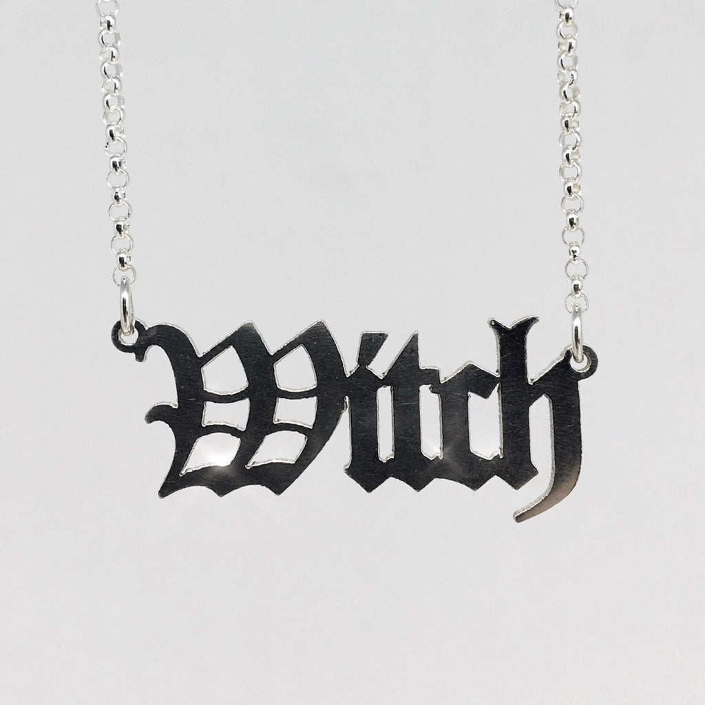 sterling silver witch nameplate necklace in gothic blackletter font.