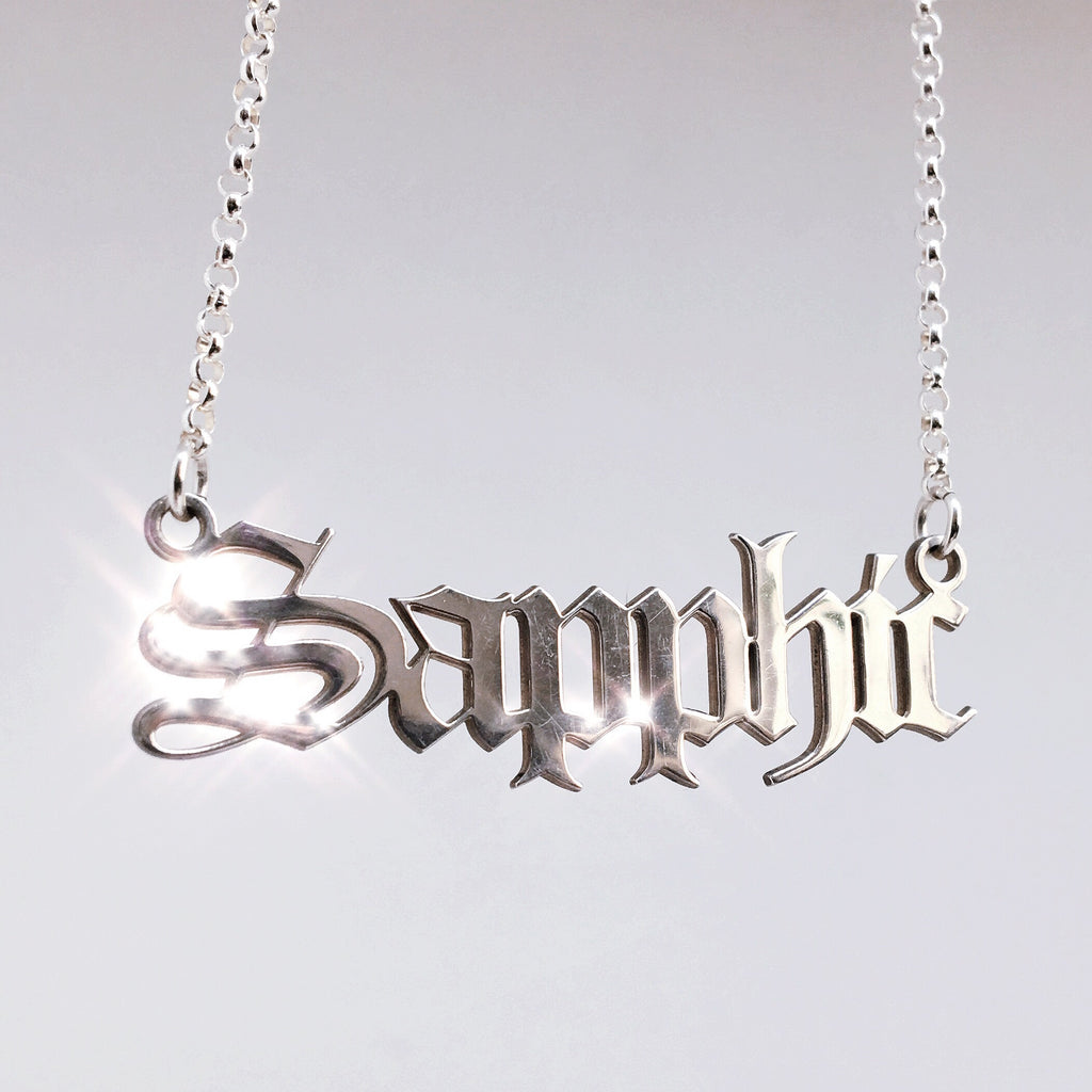 Sterling silver Sapphic nameplate necklace in gothic blackletter font.