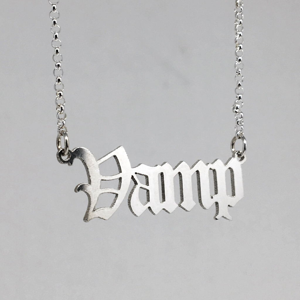 Sterling silver Vamp nameplate necklace in gothic blackletter font.
