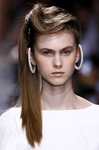 The '80s- inspired hair look was brought back at Annakiki's show, which saw big high ponytails