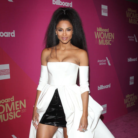 On the red carpet for Billboard Women in Music event, the host Ciara appeared in a curly ponytail and white dress